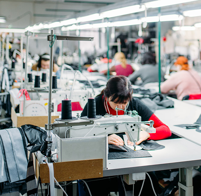 Workshop for the production of clothing, sewing machine on fabric. Dressmaking industry, Equipment on dress factory, professional tailoring